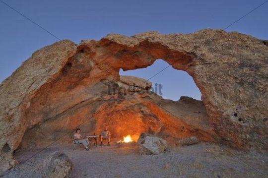 Campfire Under Rock Arch In Namib Naukluft National Park