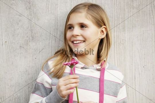 Girl pleased about a flower