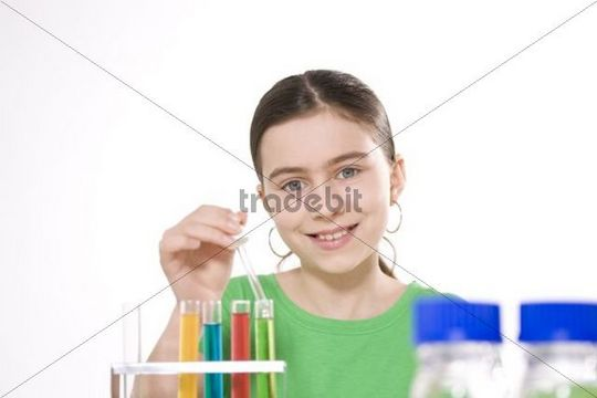 Girl working on an experiment with test tubes