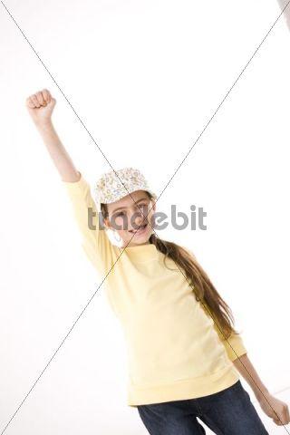 Girl dancing, wearing a hat