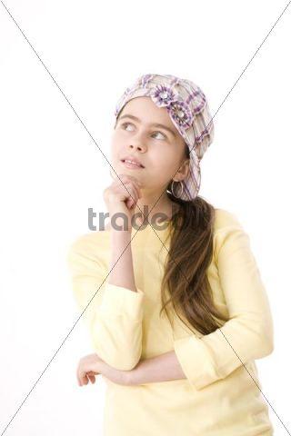 Portrait of a pensive girl, wearing a hat