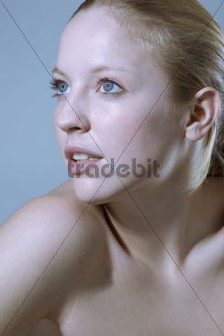 Young woman, waterdrops on her skin