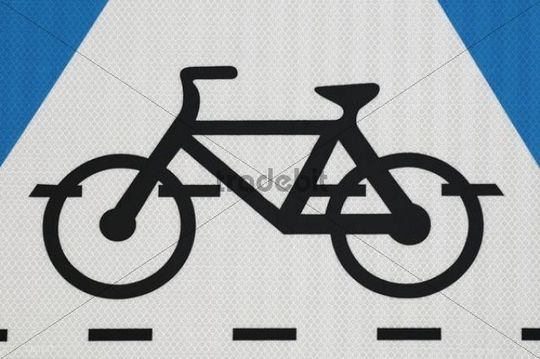 Cycle lane symbol on a sign board, close-up
