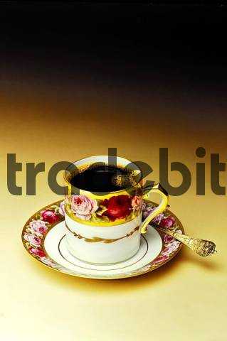 Cup of coffee with saucer and spoon