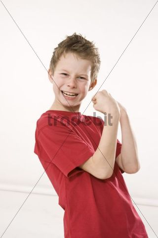 Boy with clenched fists striking a victory pose