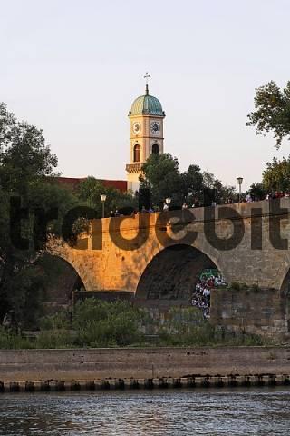 Old Stone Bridge Danube river and church St. Mang in Regensburg Bavaria Germany