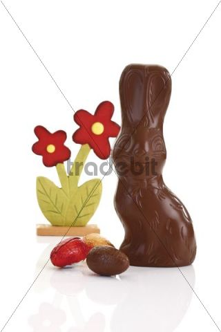 Chocolate easter bunny with easter eggs and artificail flower