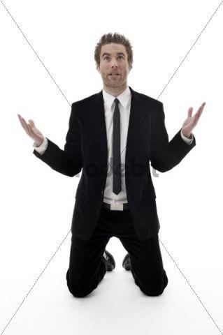 Businessman kneeling on the floor