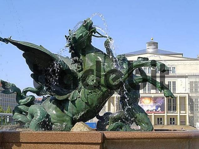 The fountain Mendebrunnen at the place Augustusplatz, in the background the opera house, Leipzig, Saxony, Germany