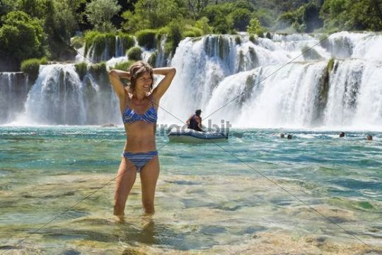Woman, 35 years old, bathing in the Krka waterfalls, Krka ...