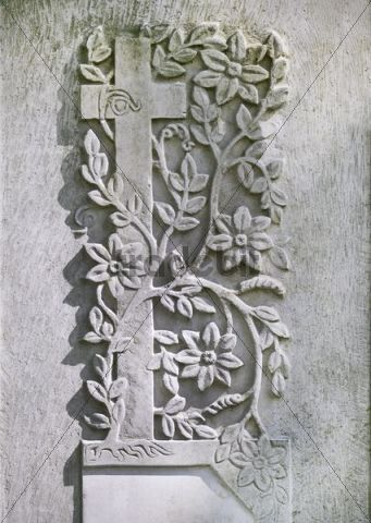 Cross entwined with flowers, relief on a tombstone