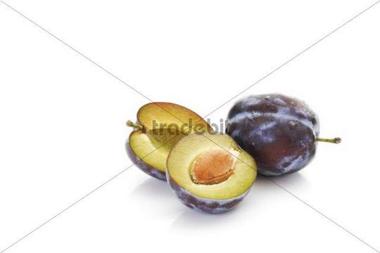 Plums (Prunus domestica), one is cut in half