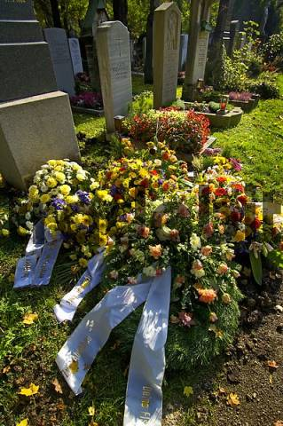 grave with floral decoration on the East Cemetary in Munich Bavaria Germany