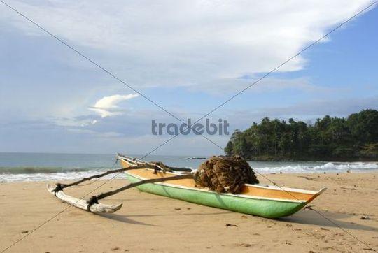 Fishing boats with outriggers on sandy beach, Talalla near Dondra, Indian Ocean, Ceylon, Sri Lanka, South Asia, Asia