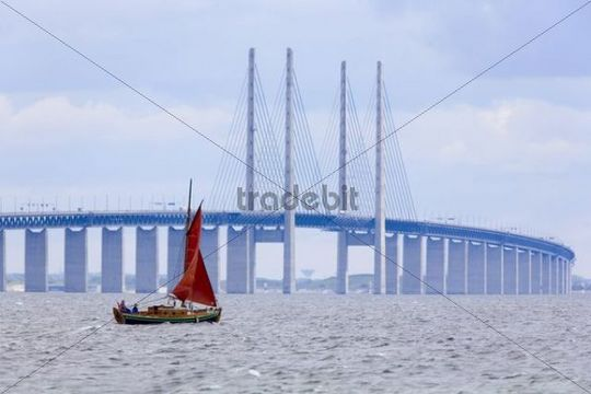 Sailing boat in front of the bridge between Denmark and Sweden