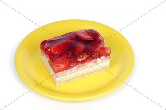 Piece of strawberry tart on a plate