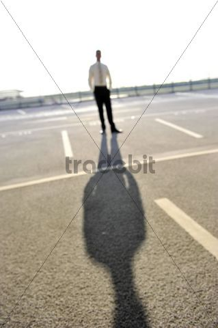 Out of focus, young, self-confident businessman, standing, wearing a suit, Hamburg, Germany, Europe
