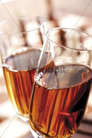 Glasses of sherry in front of a chess board