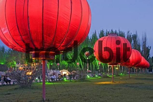 asia, china, with chinese lampions illuminated square in kashgar at silkroad.
