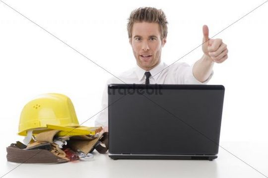 Businessman with tools and laptop