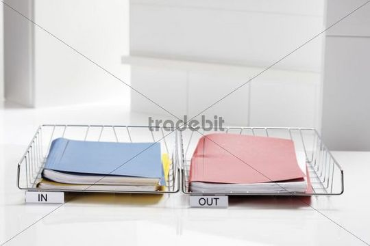 Filing baskets with folders, in, out