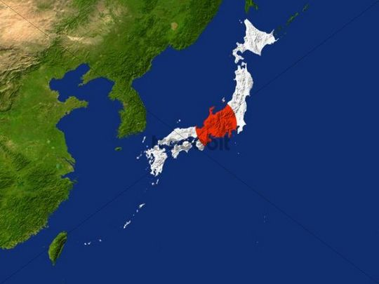 Satellite image of Japan with the country´s flag covering it