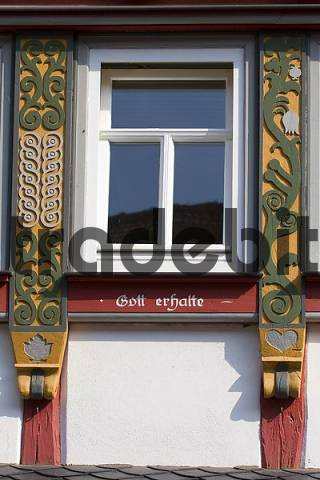 carving at a timber framed window in Lich, Hesse, Germany