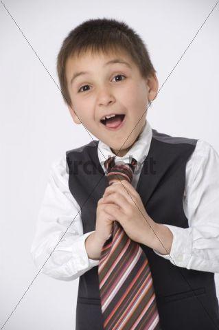 Boy, 8, dressed as a businessman