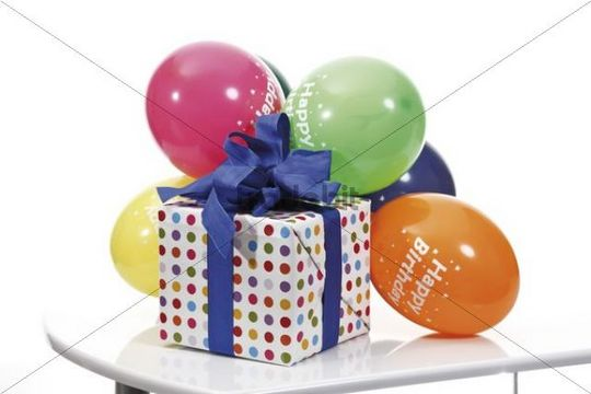 Present with a ribbon and balloons, Happy Birthday