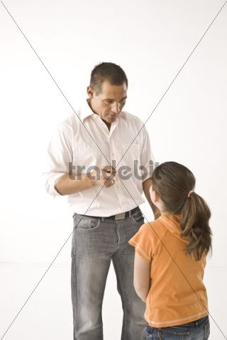 Father scolding his daughter