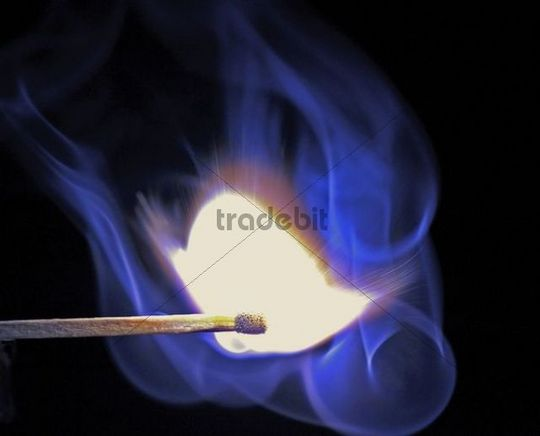 Matchstick ignites, blue smoke