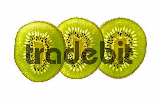 sliced kiwifruit in backlight, close up, cut out