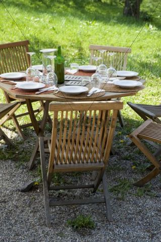 Garden furniture and laid table