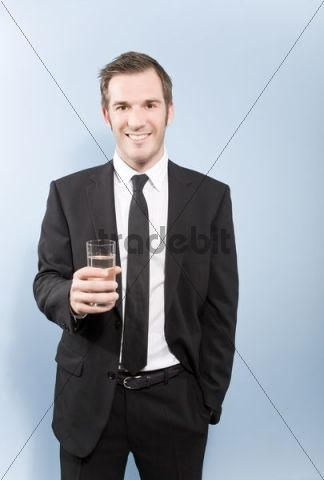 Businessman holding a glass