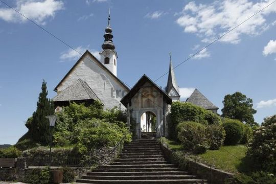 Rosary Church and parish church at back, Maria Woerth at Woerther Lake, Carinthia, Austira, Europe