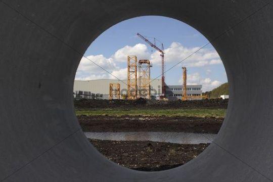Industrial area seen through a canal tube