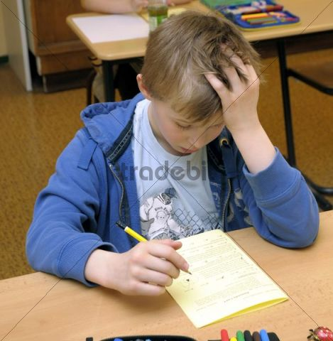Schoolboy, 10 years old, during an exam