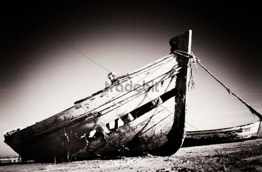 Weathered wooden boat on the beach, Andalusia, Spain, Europe