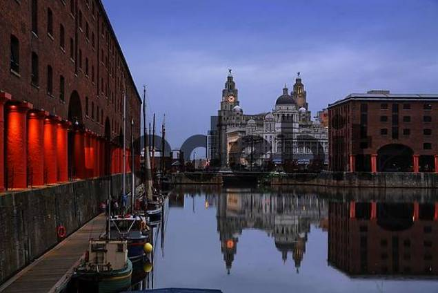 Liverpool, reflection of the three graces - The Royal Liver Building - The Gunard Building - The Port of Liverpool in Albert Dock, Liverpool, England