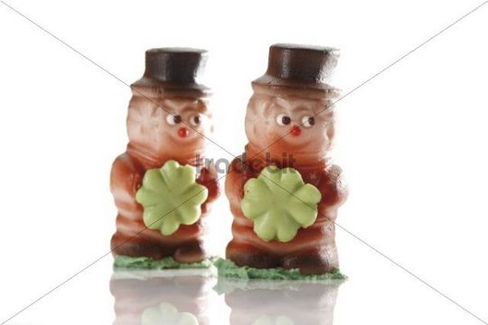 Two small chimney sweepers, made of marzipan