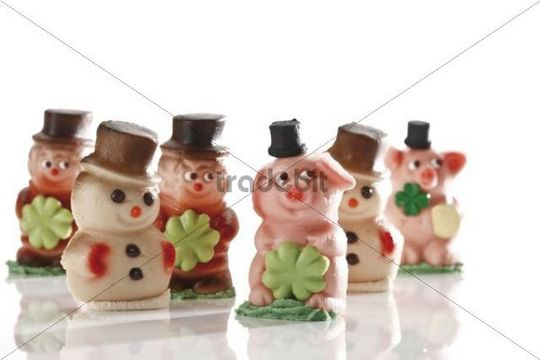 Lucky charms made of marzipan, pigs, snowmen, chimney sweeper