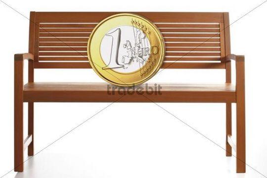Euro coin on a wooden bench, composing
