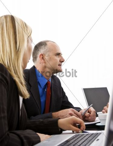 Manager and secretary at a meeting