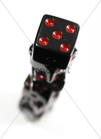 Stack of black playing dice