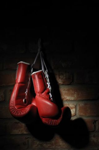 Red boxing gloves hanging on a brick wall - Download ...