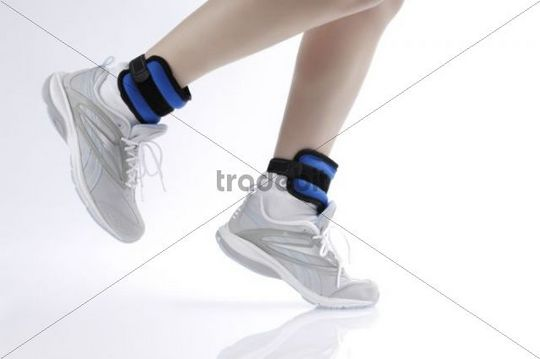 Woman jogging wearing ankle weights, detail