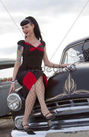 Lady sitting on the fender of a classic car, Finowfurt, Brandenburg, Germany