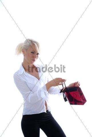 Woman looks into a small gift bag