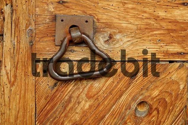 door handle on an old wooden barn door