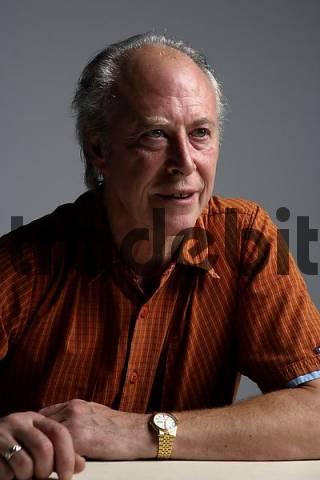 waiting mature man sitting at table